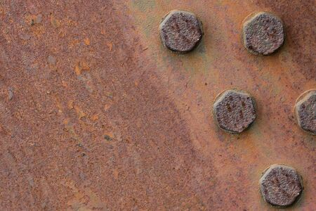 Rusty iron plate texture with bolts. Corrosion of metal. Copy space.