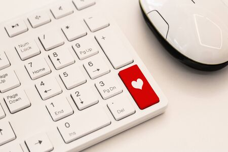 Heart sign on white computer keyboard button. Internet dating concept