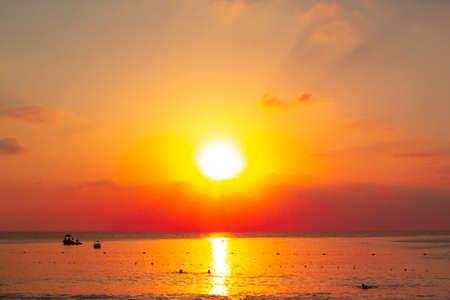 Beautiful orange sunset over the sea beach