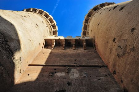 Big medieval towers of entry to the city, with holes of impacts of artillery, in valencia, spain. called towers of quart photo