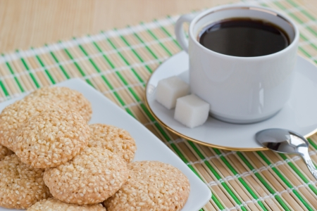 Homemade sesame seed cookies and a cup of coffee photo