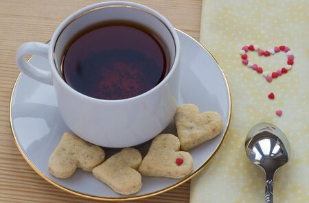 Cup of rooibos tea with heart shaped cookies for Valentines day photo