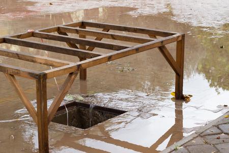 draining: Drain with rain draining away