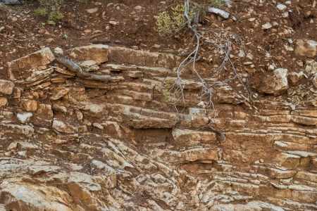crumbling: Crumbling layered sedimentary rock