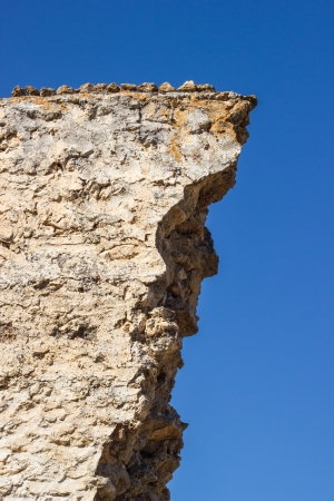 ghost rock: Crumbling rock wall in ghost town (Kayakoy) in Turkey