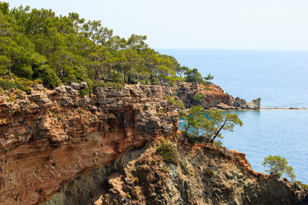 Rocky coast covered by pines in Kemer, Antalya, Turkey Banque d'images