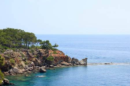 Rocky sea coast covered by pines in Kemer, Antalya, Turkey Banque d'images