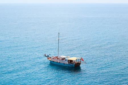 KEMER, TURKEY - MAY 2017: Tourists sailing recreationally on a motor boat anchored near shore.