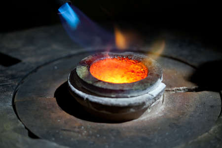 red burning hot cast mold with fire in metallurgical furnace