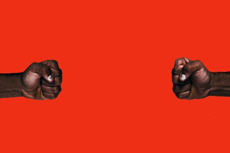 Powerful black fists calling for freedom and equality on a red background.