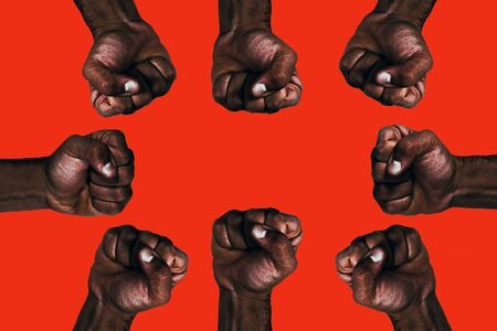 United african black fists raised calling for freedom and equality on a red background. Stock fotó