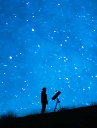 Astronomer observing the immensity of the universe and the stars. Silhouette of an astronomy lover person with a telescope observing the blue starry sky at night. Stock fotó