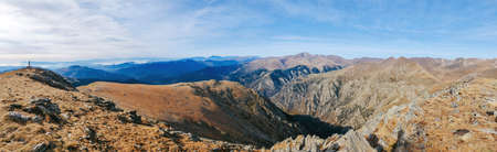 Spectacular panoramic view from the top of the mountain with different mountains in the background. Hiking, mountaineering. Balandrau mountain in Ripolles, Pirineus-Pyrenees Range, Catalunya, Spain.