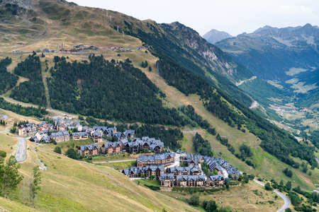 Baqueira Beret town in the Vall de Aran surrounded by beautiful green mountains. Summer tourism in Aran Valley, Pyrenees, Catalonia, Spain.