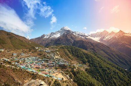View of Namche bazar and mount Thamserku with sunshine - way to everest base camp, Khumbu valley, Sagarmatha national park, Solukhumbu, Nepal