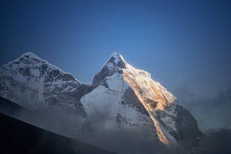 View of Mount Kangtega in Himalaya mountains at sunset. Khumbu valley, Everest region, Nepal