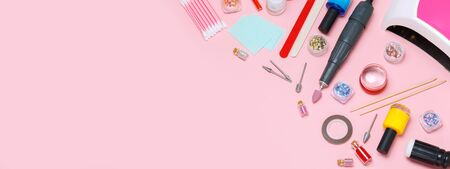 Nail care. A set of professional tools for manicure and pedicure. Beauty care. Coating nails with gel polish. Tools for creating and for the treatment of nails. Salon Banner Pink Background Imagens