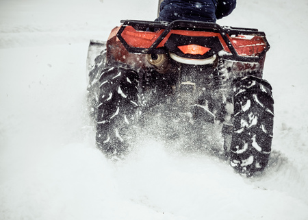 ATV slips in the snow