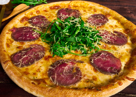 Italian pizza with beef close-up
