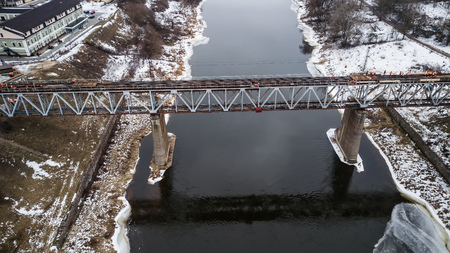 repair of the railway bridge across the river. Aerial photography with drone