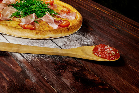 pizza on wood table with ingredients Reklamní fotografie