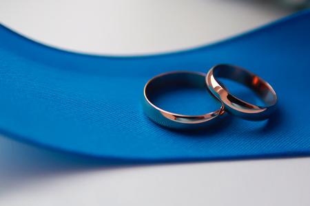 old wedding rings on blue ribbon