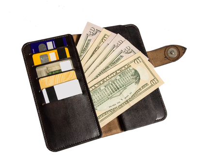 leather wallet with money and cards on white background