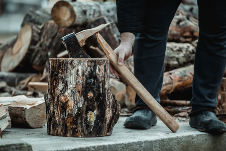 broken axe when chopping wood. The woodcutter broke the tool. Stock Photo