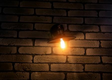 vintage lamp on brick wall background Фото со стока