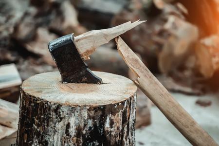 A broken axe in the wooden deck