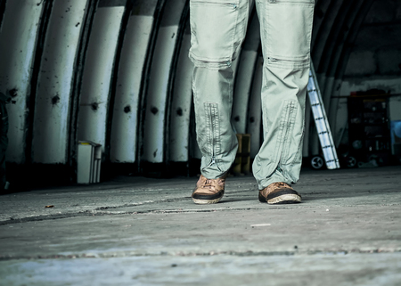 the legs of the person in the hangar Banque d'images - 120524447