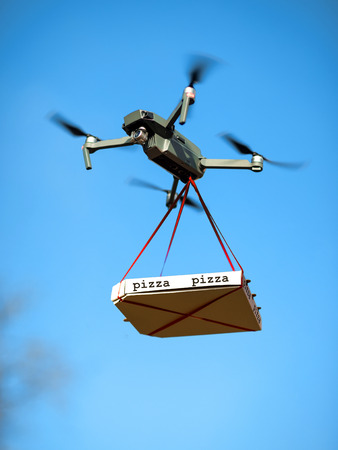delivery pizza drone. pizza is tied to the Quad