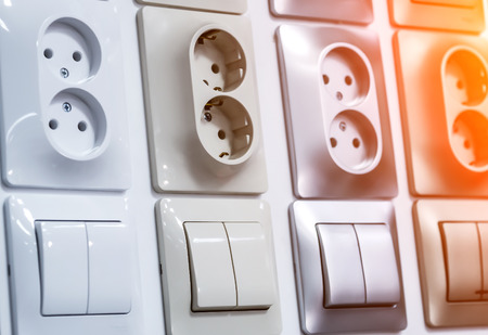 sockets and switches on the wall Stock fotó