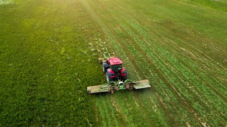 a tractor mows a field of aerial photography with drone Imagens