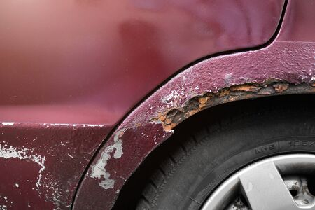corrosion of the car body. Rusty wing close-up Banco de Imagens