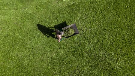 man pulls a wheelbarrow with garbage top view Stok Fotoğraf