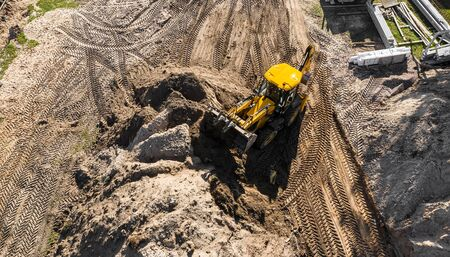 excavator working on a construction site top view
