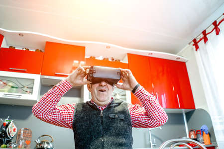 an elderly man wearing virtual reality glasses.