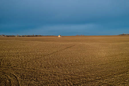 self-isolation in a lonely house in the middle of a field top view from a drone.