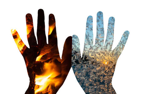 the concept of fire and ice on the palms. 免版税图像