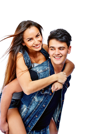 carrying girlfriend: Young man carrying girlfriend on his back. Isolated on white background.
