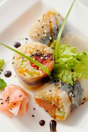 Traditional the Japanese meal sushi on a white background Stock Photo - 4619329