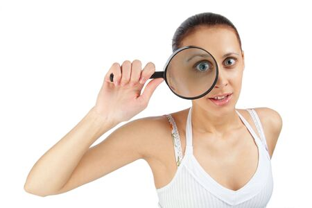The woman with a magnifier in a hand on the isolated background photo