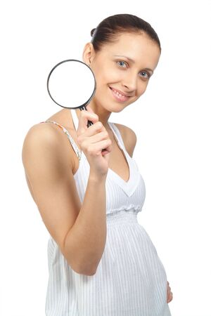 The woman with a magnifier in a hand on the isolated background Stock Photo