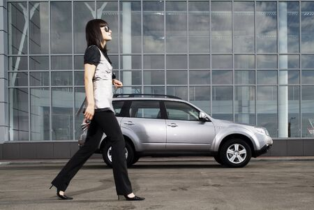 The stylish woman against the car photo