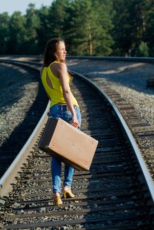 depart: The young woman walks by rail