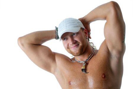 muscle shirt: El joven hombre fuerte en un fondo blanco