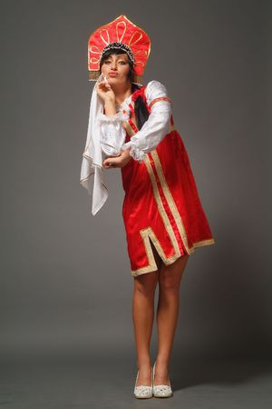The Russian woman in ancient clothes on a grey background Stock Photo - 4737872