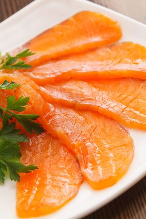 Salmon cut with slices with parsley