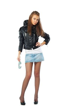 leather skirt: The fashionable young woman on a white background